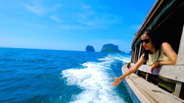 Asian Woman in Thai Taxi Boat at Railay, Krabi, Thailand