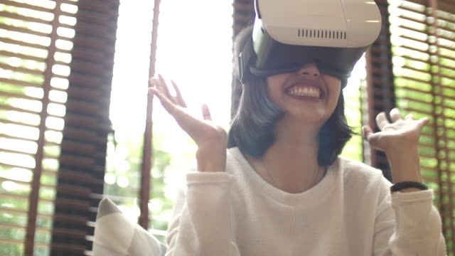 asian woman in virtual reality headset at home - imagination stock videos & royalty-free footage