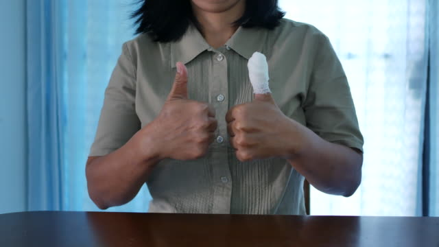 asian woman injured finger with bandage - bandage stock videos & royalty-free footage