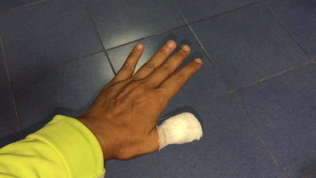 asian woman injured finger with bandage - broken stock videos & royalty-free footage