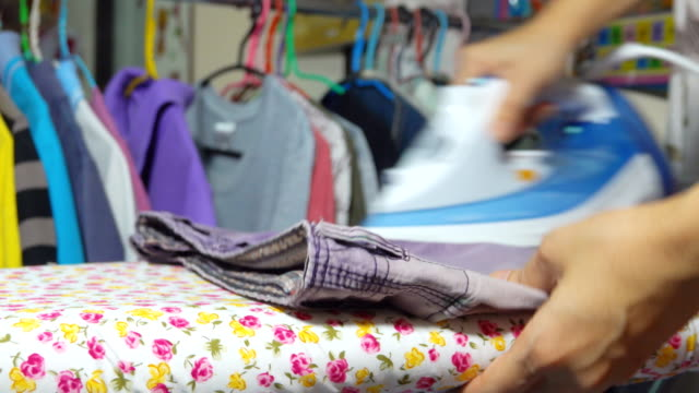 4k: asian woman ironing clothes - ironing board stock videos & royalty-free footage