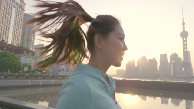 Asian Woman jogging in urban setting