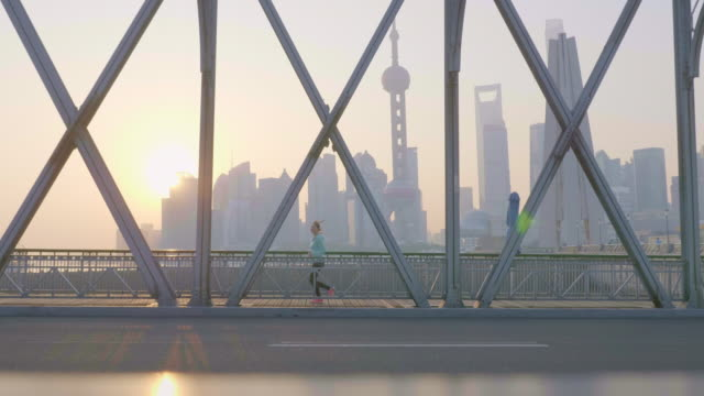 asian woman jogging in urban setting - shanghai stock videos & royalty-free footage