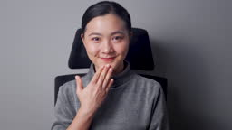 Asian woman looking at camera happy smiling and say thank you by sign language