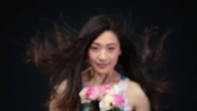 ms r/f slo mo asian woman looking up smiling / london, greater london, united kingdom - greater london video stock e b–roll