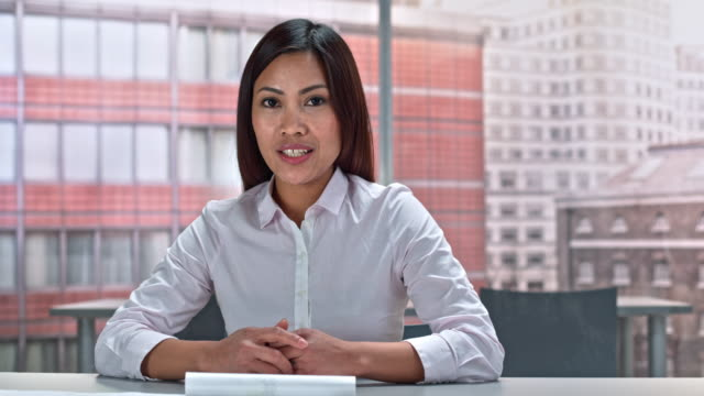 ld asian woman making a video call from her office - voip stock videos & royalty-free footage
