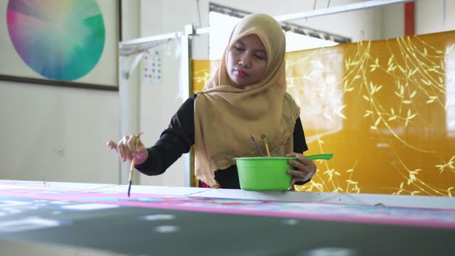 asian woman making batik - batik stock videos and b-roll footage