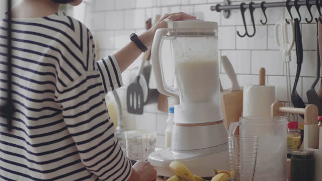 asian woman making smoothie. - smoothie stock videos & royalty-free footage