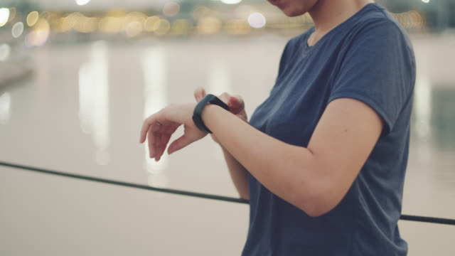 asian woman monitoring her running performance on smartwatch in morning - wrist watch stock videos & royalty-free footage