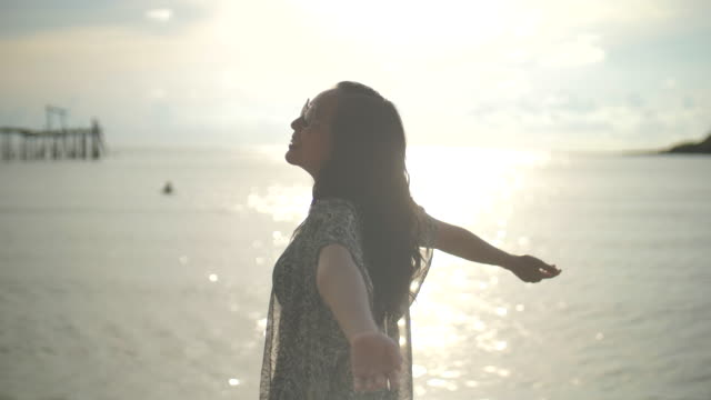 asian woman on beach with opening arms - arms raised stock videos & royalty-free footage