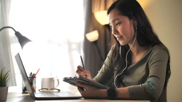 asian woman online learning at home - e learning stock videos & royalty-free footage