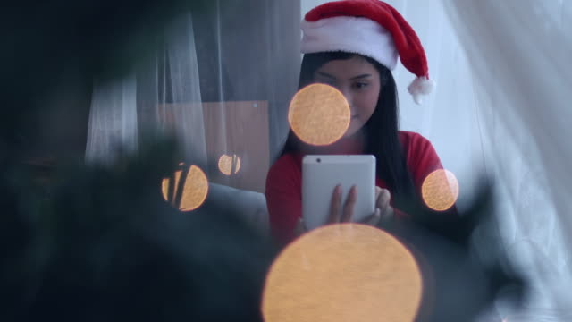 asian woman online shopping on christmas event, panning right video 4k. - santa hat stock videos & royalty-free footage
