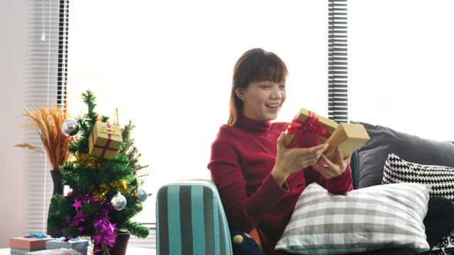 asian woman opening gift box on christmas day at home - disappointment stock videos and b-roll footage