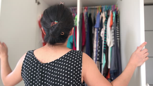 asian woman opening wardrobe and looking the cloth for new alignment - wardrobe stock videos & royalty-free footage