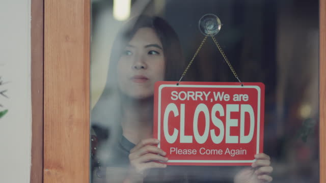 asian woman owner closing the coffee shop - shop sign stock videos & royalty-free footage