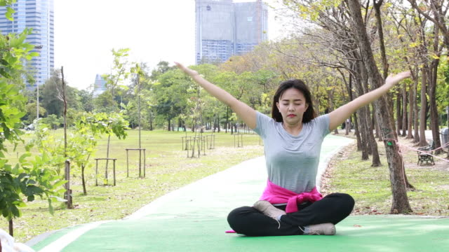 asian woman play yoga in garden - mindfulness stock videos and b-roll footage