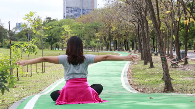 asian woman play yoga in garden - overweight yoga stock videos & royalty-free footage