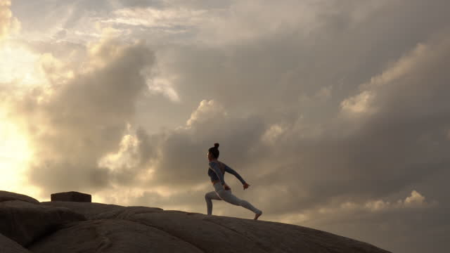 asian woman practicing yoga at mountain . - the human body stock videos & royalty-free footage