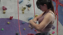 Asian woman prepare and climb wall