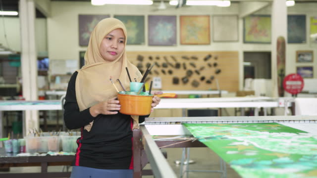 asian woman preparing to colour the patterns on batik - batik stock videos and b-roll footage