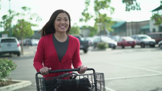MS TS Asian woman pushing a shopping cart
