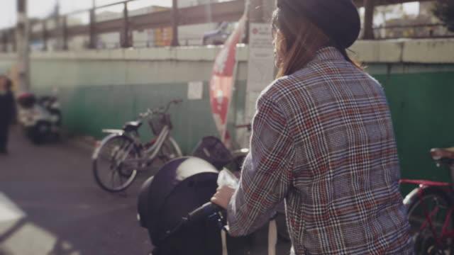 asian woman pushing baby stroller - pushchair stock videos & royalty-free footage