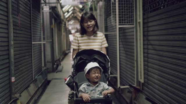 asian woman pushing baby stroller - pushchair stock videos and b-roll footage