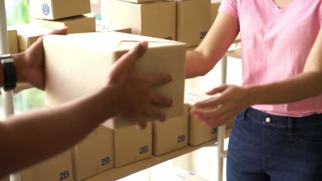 asian woman receiving delivery package - receiving stock videos & royalty-free footage