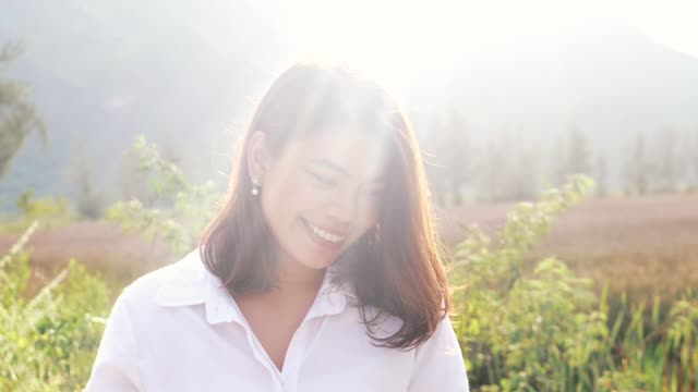 asian woman relaxing at nature outdoor, lifestyle concept. - shirt stock videos & royalty-free footage