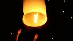 Asian Woman Releasing A Sky Lantern