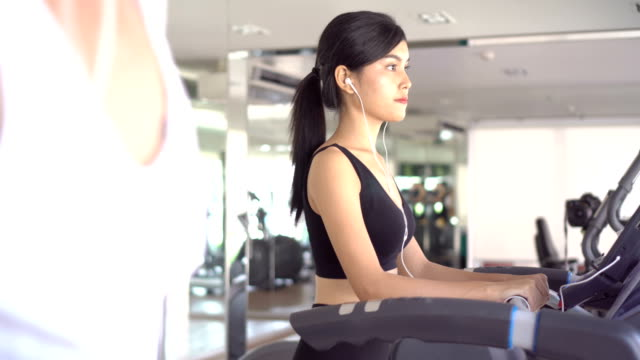 asian woman running on machine - mar stock videos & royalty-free footage