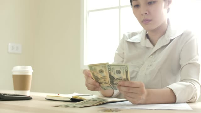 asian woman see the budget this month - bill legislation stock videos & royalty-free footage