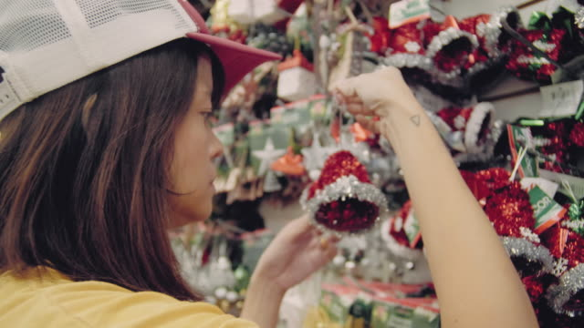 asian woman shopping for christmas at the supermarket - decoration stock videos & royalty-free footage