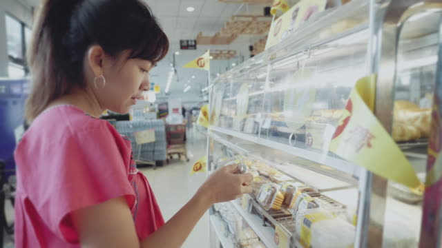 asian woman shopping for groceries. - packaging stock videos & royalty-free footage