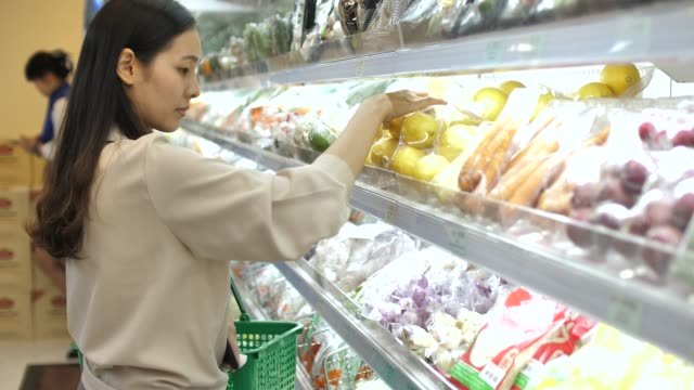 asian woman shopping fresh fruit and vegetable in supermarket - nutrition label stock videos and b-roll footage
