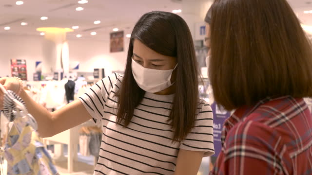 asian woman shopping in department store during covid19 and coronavirus outbreak. - showroom stock videos & royalty-free footage