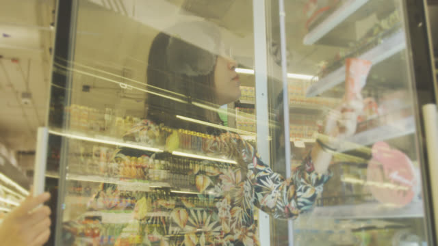 asian woman shopping in supermarket - packaging stock videos & royalty-free footage