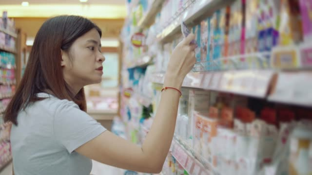 asian woman shopping in supermarket, - labelling stock videos & royalty-free footage