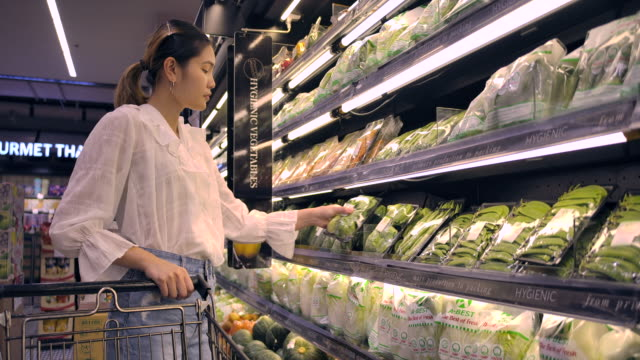 asian woman shopping in supermarket - convenience stock videos & royalty-free footage