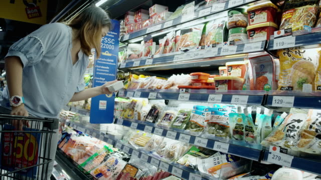 asian woman shopping in supermarket - frozen food stock videos & royalty-free footage