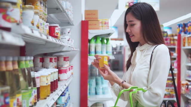 asian woman shopping in supermarket - for sale stock videos and b-roll footage