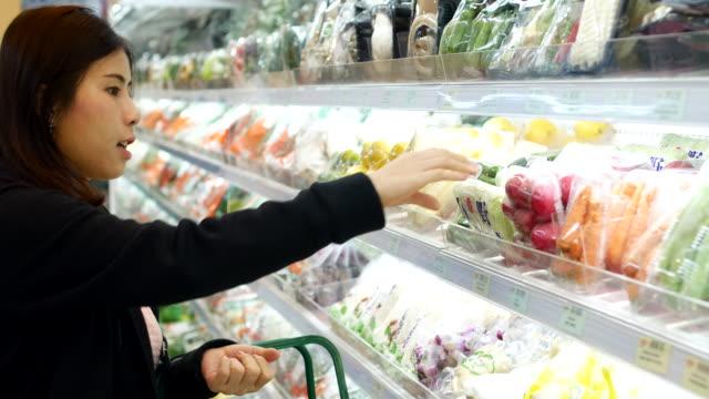 asian woman shopping in supermarket - freshness video stock e b–roll
