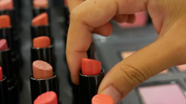 asian woman shopping lipstick - lipstick stock videos & royalty-free footage