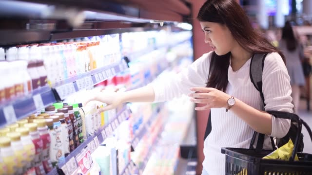 asian woman shopping on dairy product in supermarket - choosing stock videos & royalty-free footage