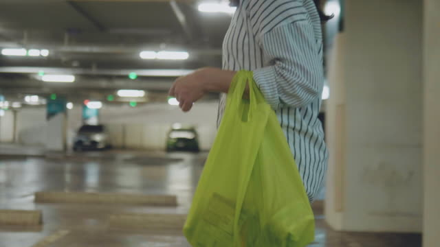 asian woman shopping with plastic free grocery bags. - bag stock videos & royalty-free footage