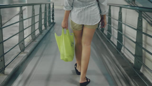asian woman shopping with plastic free grocery bags. - reusable bag stock videos & royalty-free footage