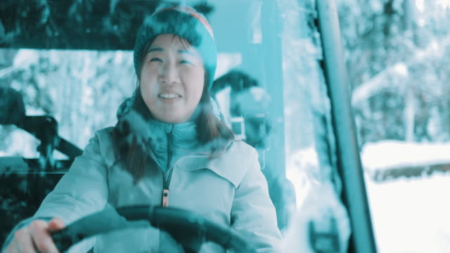 asian woman sitting in a quad bike in winter - chinaface stock videos & royalty-free footage