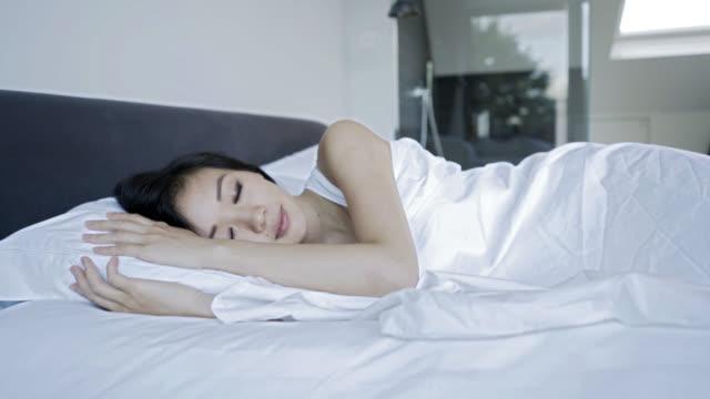 Asian woman sleeping comfortable at home