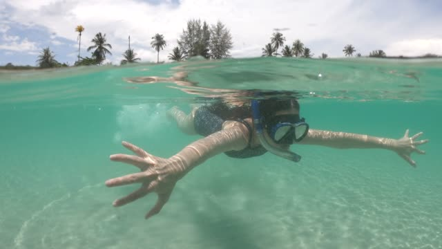 Asian woman snorkeling Diving Underwater