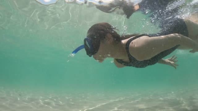 asian woman snorkeling on sea - swimming goggles stock videos & royalty-free footage